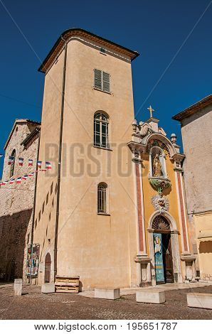Vence, France - July 13, 2016. View of of church facade under sunny blue sky in Vence, a stunning medieval town completely preserved. Alpes-Maritimes department, Provence region, southeastern France