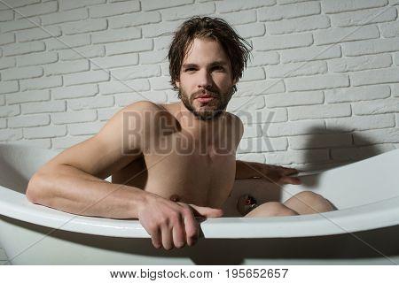 Guy Sitting In Bath Tub