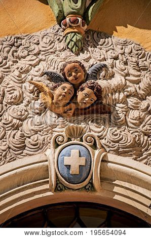 View of sculpture of faces of angels on church facade of Vence, a stunning medieval hamlet completely preserved. Located in the Alpes-Maritimes department, Provence region, southeastern France