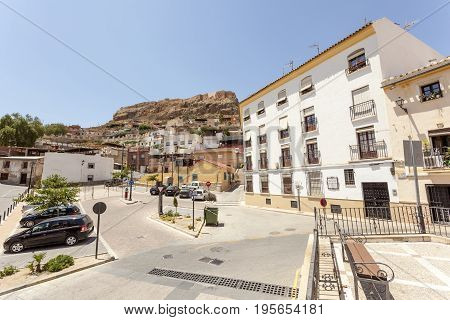 Square in the old town of Lorca with the view of medieval castle on top of the hill. Murcia province Spain