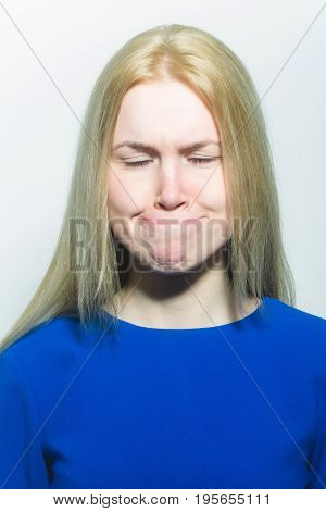 Woman With Closed Eyes Hiding Lips In Mouth