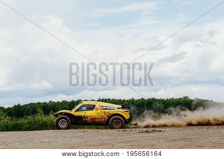 Filimonovo Russia - July 10 2017: chinese riders on rally car driving on dust road during Silk way rally