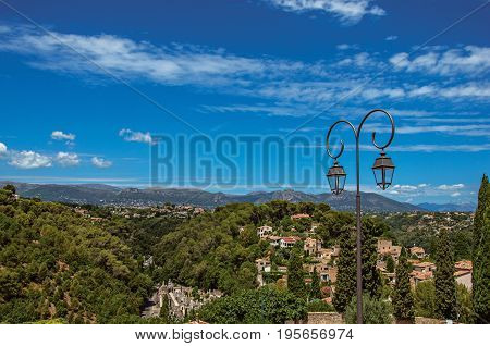 Panoramic View of hills, rooftops and lamp in Haut-de-Cagnes, a pleasant village on top of a hill, near Nice. Located in the Alpes-Maritimes department, Provence region, southeastern France