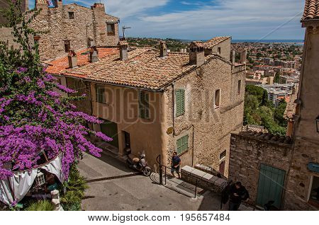 Haut-de-Cagnes, France - July 14, 2016. View of houses, rooftops and blue sky in Haut-de-Cagnes, a pleasant village on top of a hill. Alpes-Maritimes department, Provence region, southeastern France