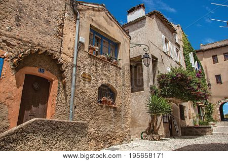Haut-de-Cagnes, France - July 14, 2016. View of alley with houses and flowered creeper in Haut-de-Cagnes, a pleasant village on top of a hill. In Alpes-Maritimes department, Provence region