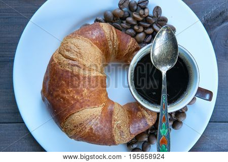 Croissant And Coffee For A Quick Breakfast To Begin A Successful Day