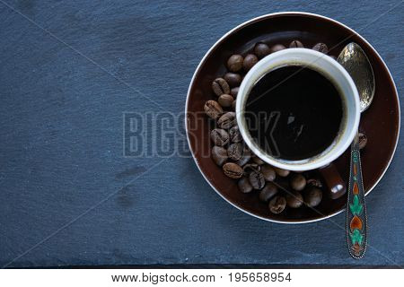 Small Cup Of Espresso And Aromatic Coffee Beans