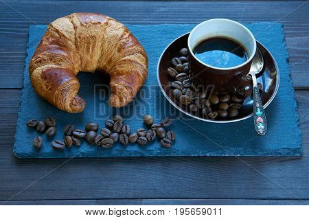 Slate Tray With A Romantic Breakfast Croissant And Coffee