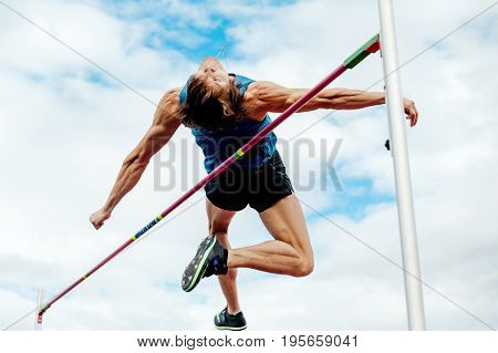 Chelyabinsk Russia - July 7 2017: high jump male athlete during Ural Championship in athletics