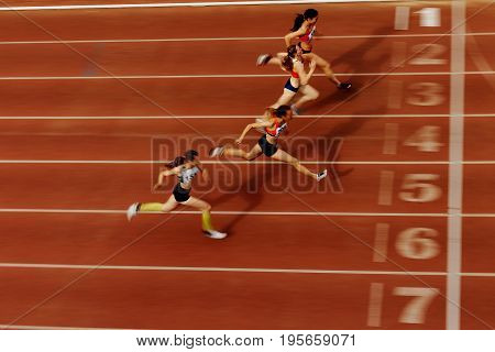 Chelyabinsk Russia - July 7 2017: blurred motion finish of race athlete runners during Ural Championship in athletics