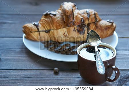Espresso Coffee And Crunchy Croissant With Chocolate