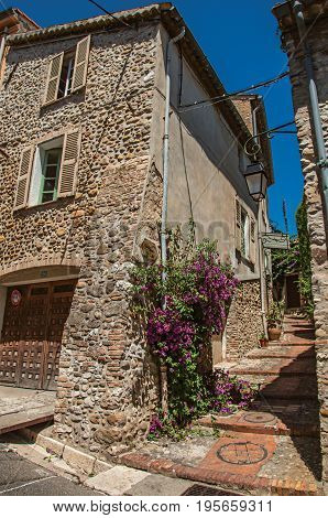 Haut-de-Cagnes, France - July 14, 2016. View of alley with house on the slope and flowers in Haut-de-Cagnes, a pleasant village on top of a hill. In Alpes-Maritimes department, Provence region