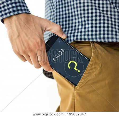 Hand holding digital device network graphic overlay in trouser pocket