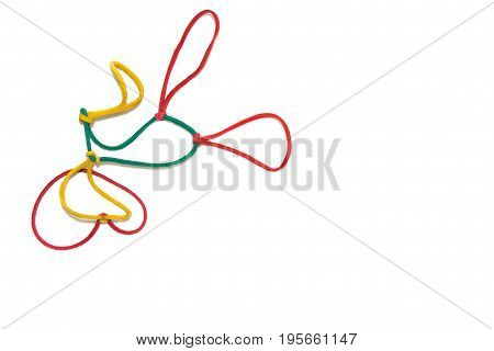 Joined multi color rubber bands isolated on white with copy-space