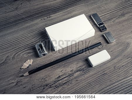 Photo of blank stationery elements. Business cards pencil eraser and sharpener on wooden table background. Responsive design mockup.