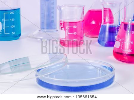 science and clinic background. Chemical and Medical laboratory research.  laboratory beakers and  petri dishes with colorful liquids and reagents.