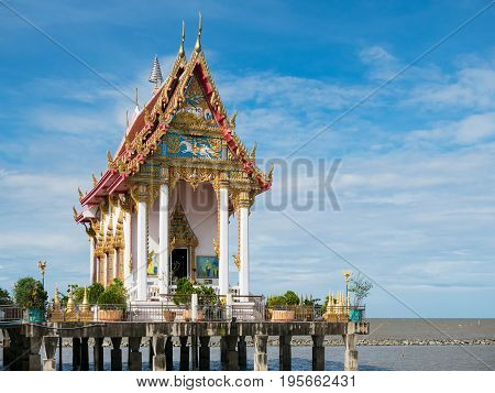 Wat Hong Thong a temple built on a concrete platform at the coast of Chachoensao in Thailand after the sea started to reclaim the area of the original temple several decades ago as a result of erosion.