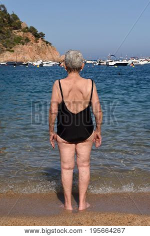 Portrait Of An Older Woman Coming Back Into The Sea