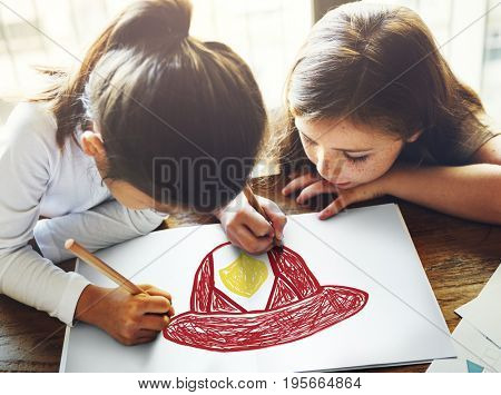 Child with a drawing of firefighter helmet