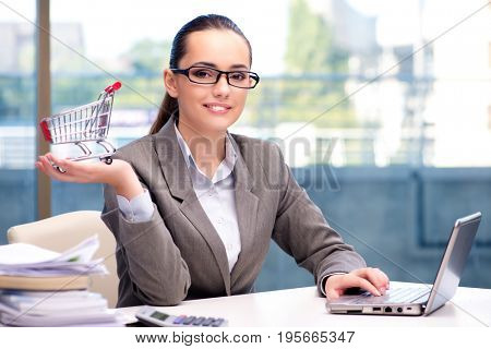 Businesswoman with small shopping cart