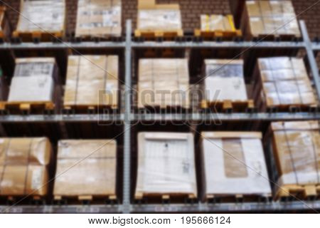 interior of warehouse blurring. Rows of shelves with boxes