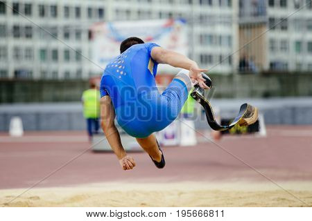 athlete disabled on carbon prosthetic long jump