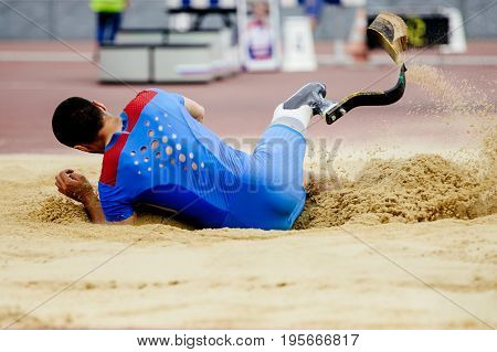 long jump athlete disabled landing in sand
