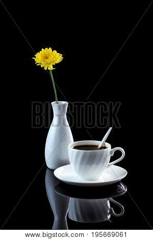Composition With Cup Of Coffee And Yellow Chrysanthemum On A Black Reflective Background