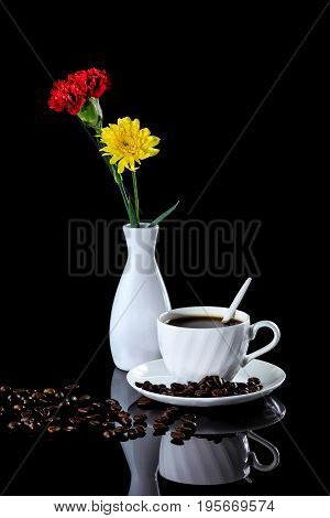 Composition Of Coffee, Yellow Chrysanthemum And Red Carnation On A Black Reflective Background