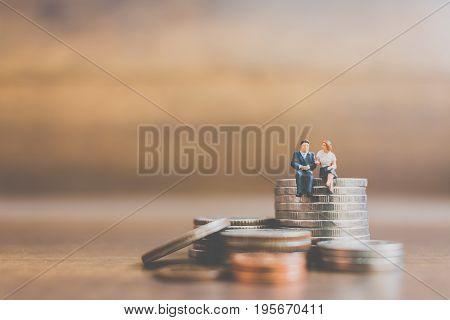 Miniature People Businessman  On Coins