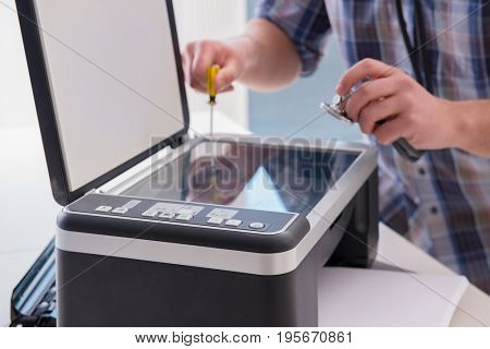 Repairman repairing broken color printer