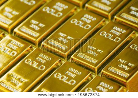 selective focus on shiny gold bars as financial investment and wealth concept.