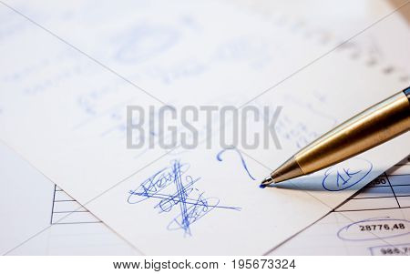 draft of business plan calculation pen and paper