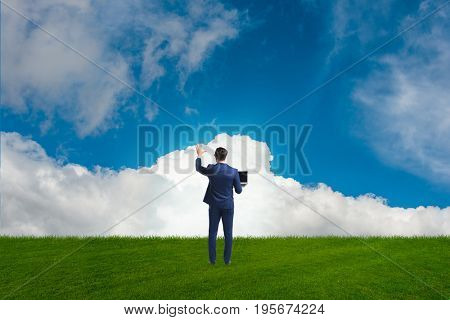 Businessmam pressing virtual buttons in the sky