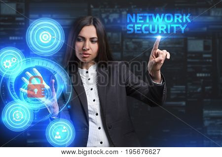 The concept of business technology the Internet and the network. A young entrepreneur working on a virtual screen of the future and sees the inscription: Network security