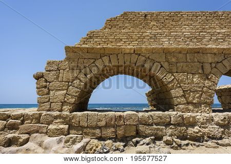 Ancient Roman aqueduct in Ceasarea at the coast of the Mediterranean Sea Israel built by Herod Israel