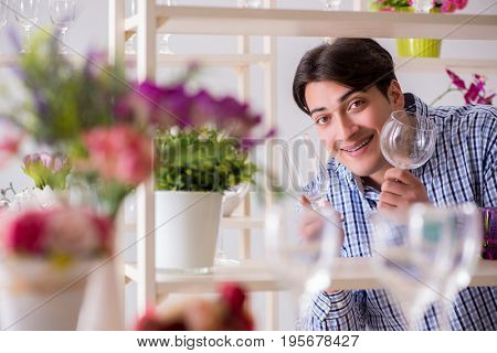 Young handsome man shopping in shop