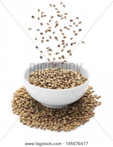 Hemp seeds falling into bowl on white background. Superfood concept