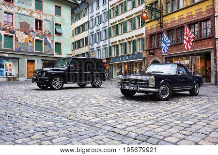 LUCERNE SWITZERLAND - JUNE 14 2017: Vintage oldtimer and modern Mercedes cars parked on the picturesque Weinmarkt square in Luzerne