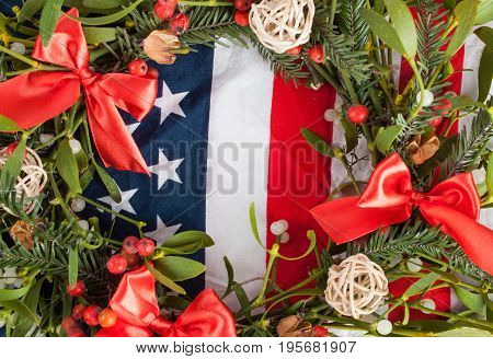 Christmas Wreath With Mistletoe On Wood Board.