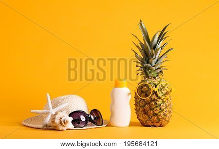 Pineapple with glasses and summer themed objects