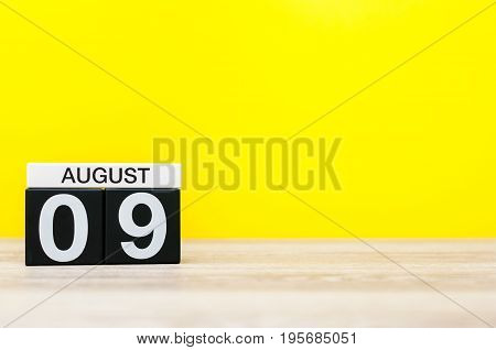 August 9th. Image of august 9, calendar on yellow background with empty space for text. Summer time.