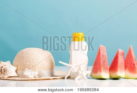 Sliced watermelon on with summer themed objects