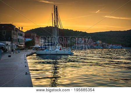Sunset over Vis town in South of Croatia, Mediterranean travel resorts.