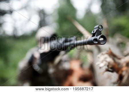 Photo of soldier with arms in forest, focus on arms