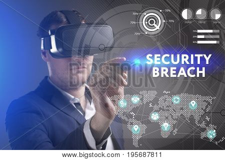 Business Technology Internet and network concept. Young businessman working in virtual reality glasses sees the inscription: Security breach