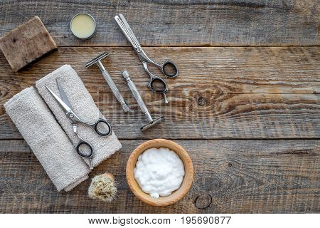 Preparing for men shaving. Shaving brush, razor, foam, scissors on wooden table background top view.