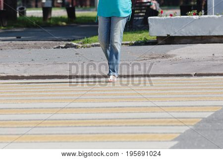 Crosses the road on the transition in sunny day