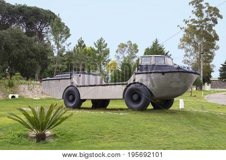 Vintage amphibious car parked on the grass