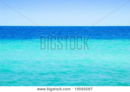 Beautiful shades of turquoise ocean blue on a summers day